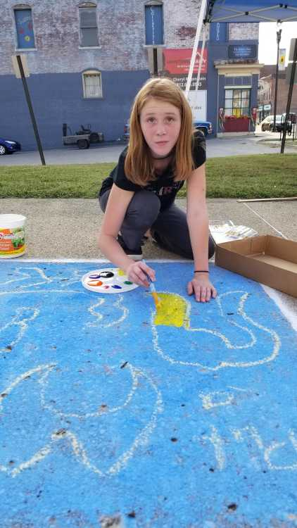 Children decorate City Hall sidewalk for Route 40 Fest